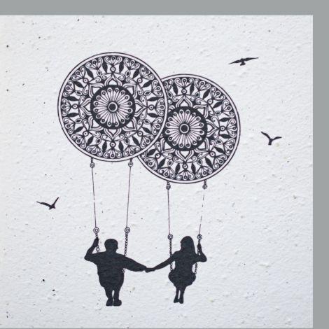 Growing Paper Couple on Mandala Swing